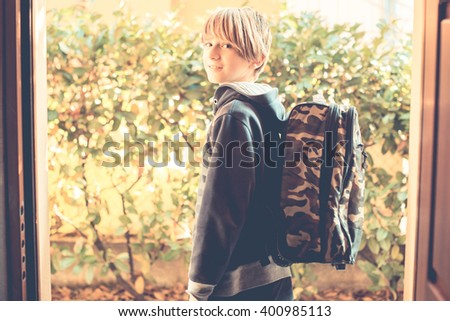 an ordinary day - schoolboy go to school - stock photo
