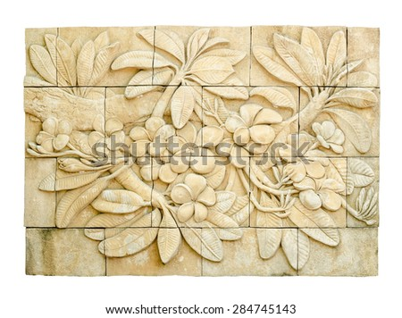 An oriental stone inscription carving of a Plumeria flower in isolated background. It is ancient art object in Asia. - stock photo
