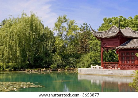 An oriental themed garden with lily pond. - stock photo