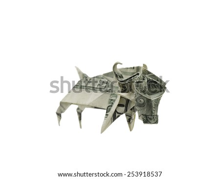 An origami bull made of a dollar bill.  This may represent bull market in capitalist economy. - stock photo
