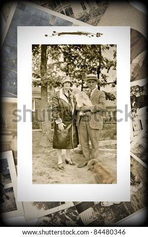 An original vintage photograph of a couple with a baby on a background of old pictures. - stock photo