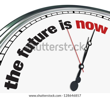 An ornate clock with the words The Future is Now on its face - stock photo