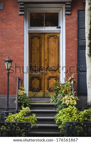 an ornate door on a row house in a large city - stock photo