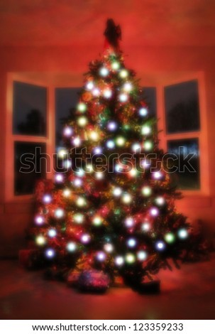 an out of focus christmas tree (bokeh effect) - stock photo