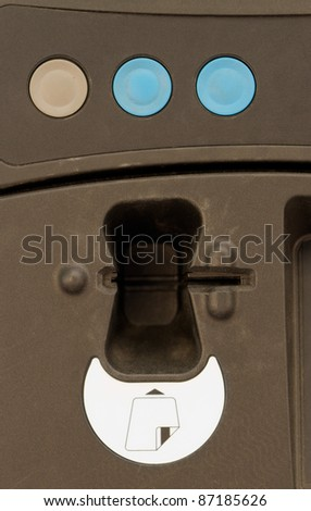 An outdoor vending machine with three buttons and a slotted magnetic card reader. - stock photo