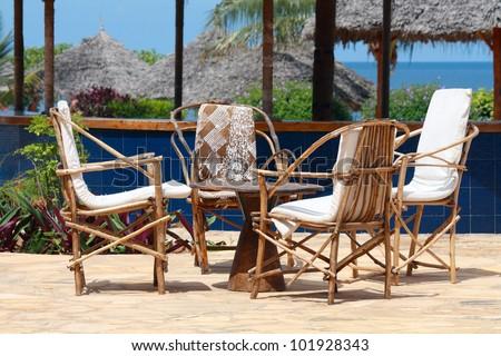 An outdoor wooden bar table in Zanzibar on a sunny day - stock photo