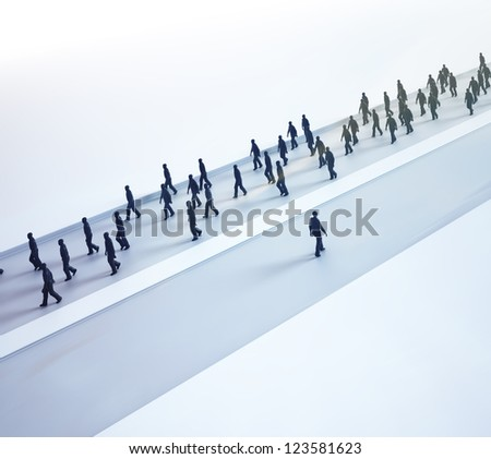 An outlier choosing his own path - tiny people walking in different directions - stock photo
