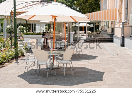 An outside cafe in Warsaw park Lazienki. - stock photo