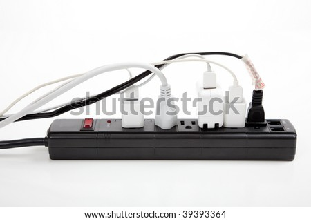 An over loaded black surge protector on a white background - stock photo