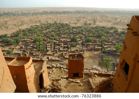 An overview of a Dogon village through mud dwellings in Mali - stock photo