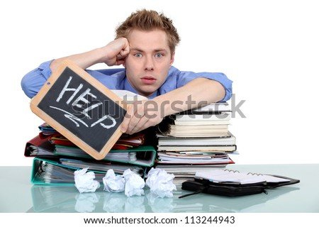 An overworked office worker - stock photo