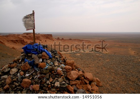 An ovoo looking out from a ridge over the Gobi Desert, southern Mongolia - stock photo