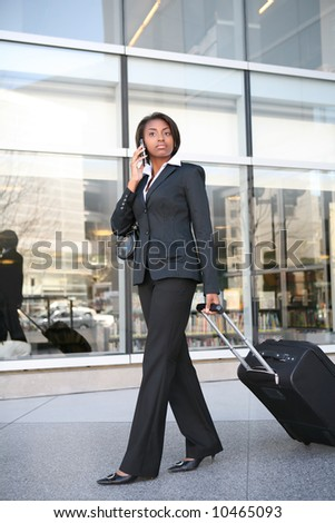 An pretty african american business woman travelling - stock photo
