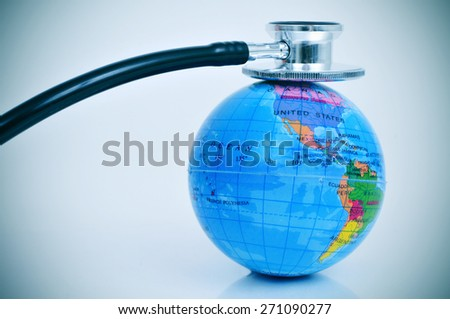 an stethoscope on a terrestrial globe depicting the concept of check up the health of the planet earth - stock photo