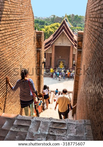 An unidentified groups of tourists and travelers in Wat Yai Chai Mongkol temple in Ayutthaya Thailand - stock photo