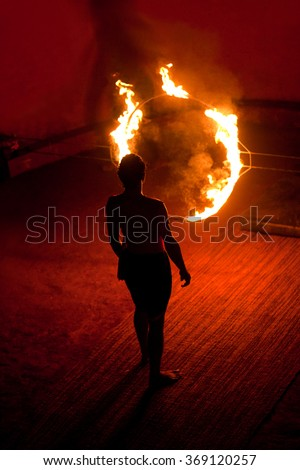 An unidentified Kalaripayattu master before jumping through fire ring during Kalaripayattu martial arts demonstration in Kerala, India.  - stock photo