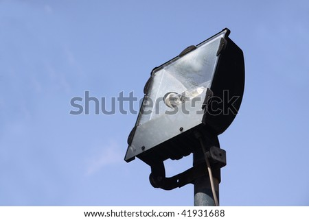 an unlit flood light used to illuminate a large area - stock photo