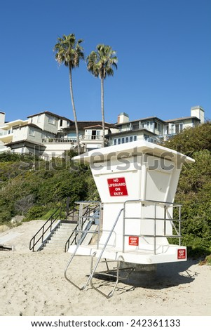 An unmanned lifeguard tower on a beach where the wealthy reside. - stock photo