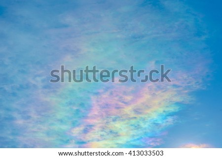 An unusual flat rainbow above the Swiss Alps in mid winter. - stock photo