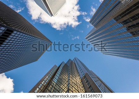 An upwards perspective of modern skyscrapers - stock photo
