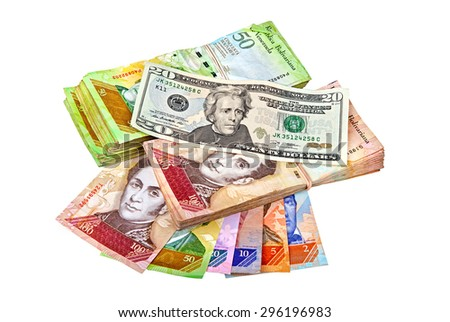An US twenty dollars bank note over bundles of Venezuelan bank notes - stock photo