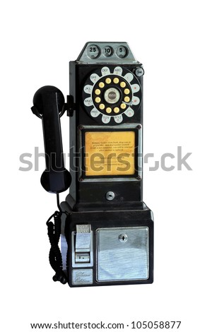 An vintage pay phone isolated on white background with clipping path - stock photo