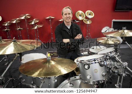 ANAHEIM, CA - JANUARY 23: Josh Freese hangs out at the Paiste booth at this years NAMM Show at the Convention Center in Anaheim, CA on January 23, 2013. - stock photo