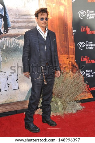 """ANAHEIM, CA - JUNE 22, 2013: Johnny Depp at the world premiere of his new movie """"The Lone Ranger"""" at Disney California Adventure.  - stock photo"""