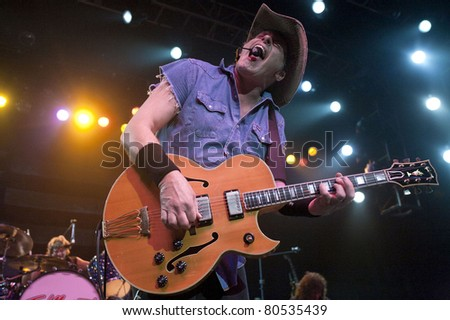 ANAHEIM, CA - JUNE 30: Ted Nugent strikes a chord to a sold out show at the Grove Theatre in Anaheim, CA on June 30, 2011. - stock photo