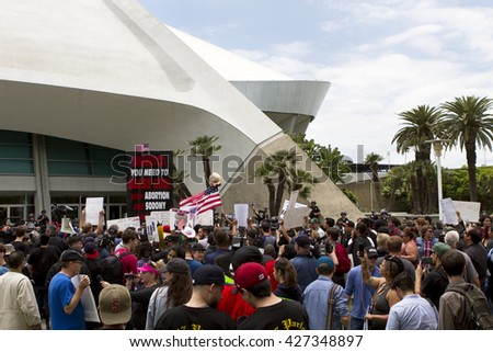 ANAHEIM, CA - MAY 25, 2016: A protesters gather outside the Donald Trump campaign rally at the Anaheim Convention Center, in Anaheim, California.  - stock photo