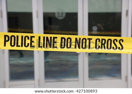 ANAHEIM CALIFORNIA, May 25, 2016: Genuine Crime Scene Tape and Police Do NOT Cross tape block access to entrances during the Republican Nominee Donald J. Trump Rally Anaheim 5.25.2016  - stock photo