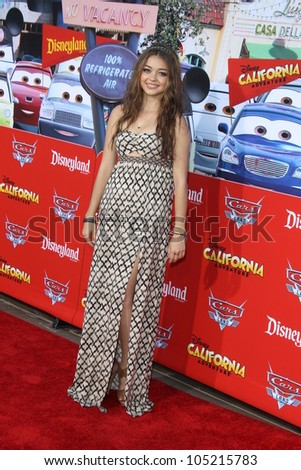 """ANAHEIM - JUN 13:  Sarah Hyland arrives at the """"Cars Land"""" Grand Opening  at California Adventure on June 13, 2012 in Anaheim, CA - stock photo"""