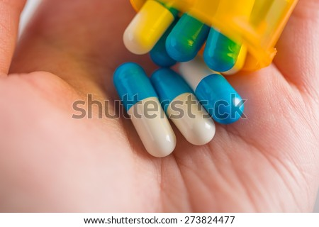 Analgesic. Extreme close-up view of various pills - stock photo