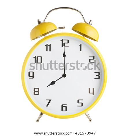 Analog alarm clock showing eight o'clock isolated on white background - stock photo