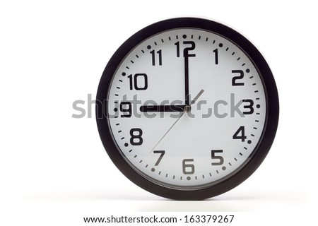 Analog clock with black frame, showing 9 o'clock as typical start of working hours. Cutout, studio shot, isolated on white background. - stock photo