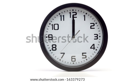 Analog clock with black frame, showing time of 12 o'clock sharp, noon or midnight. Cutout, studio shot, isolated on white background. - stock photo