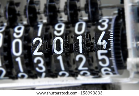 analog meter that marks 2014 happy new year - stock photo