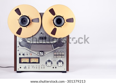 Analog Stereo Open Reel Tape Deck Recorder Player with Metal Reels - stock photo