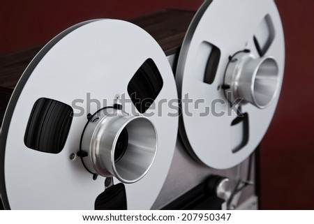 Analog Stereo Open Reel Tape Deck Recorder Spool - stock photo
