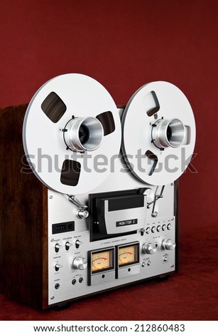 Analog Stereo Open Reel Tape Deck Recorder Vintage Closeup - stock photo