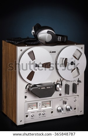 Analog Stereo Reel Tape Deck Recorder Player with headphones - stock photo