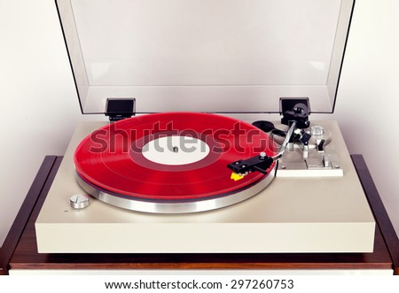 Analog Stereo Turntable Vinyl Record Player with Red Disk - stock photo