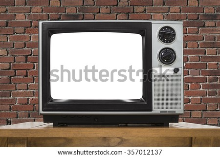 Analog television with brick wall and cut out screen.   - stock photo