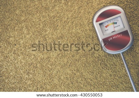 analog tool to measure soil ph on a rough textured background - stock photo