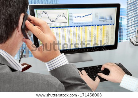 Analysing  Financial Data and Charts on Computer Screen  - stock photo