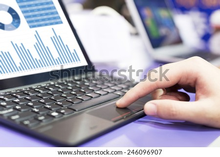 analysis financial report on laptop - stock photo