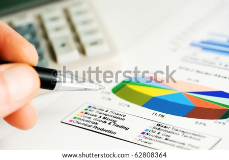 Analysis of financial reports. - stock photo