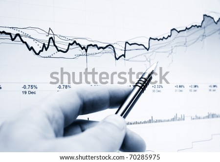 Analysis of stock market graphs - stock photo