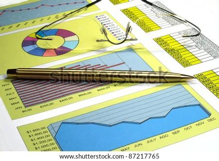 Analysis of stock market graphs. - stock photo