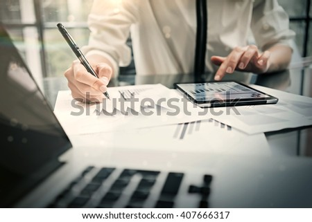 Analytical department working process.Closeup photo business woman showing reports modern tablet screen.Statistics graphics screen.Banker holding pen for signs documents, new startup. Horizontal - stock photo